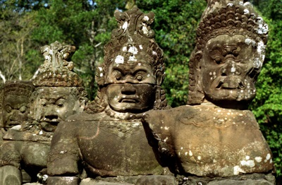 Heads of demons from the entrance to the southern gate of Angkor Thom, Angkor, Cambodia
